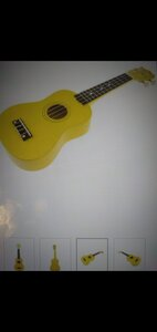 Used Yellow guitar 21 inch in Dubai, UAE