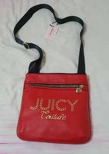 Used Authentic Juicy Couture sling bag in Dubai, UAE
