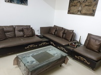 Used Leather Sofa with table in Dubai, UAE