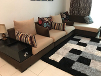 Used L shaped Sofa with a Coffee Table. in Dubai, UAE