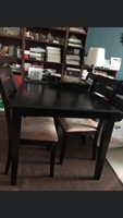 Used Wooden table with4chairs 300aed in Dubai, UAE