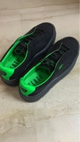 Used PUMA Black and green shoes in Dubai, UAE