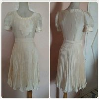 Biege brand new dress small size