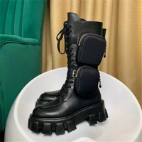 Used Prada boots with pockets  in Dubai, UAE