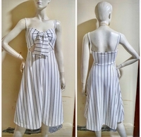 Used White stripe dress/small to medium size in Dubai, UAE