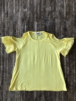 Used T-shirt for a girl 10-12 years old  in Dubai, UAE