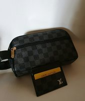 Used Hand pouch and card holder new LV in Dubai, UAE