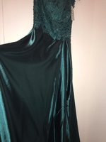 Used HZWL emerald green long dress with slit in Dubai, UAE