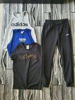 Used Adidas bundle:1 pants & 3 tops in Dubai, UAE