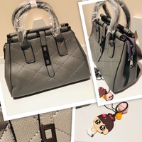 Used Grey handbag with free key chain  in Dubai, UAE
