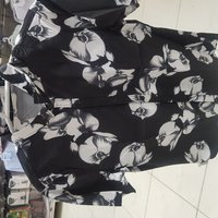 Used T shirt light flowers CLOTHS in Dubai, UAE