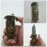 "Used Pirates of Caribbean"" ligter with knife, in Dubai, UAE"