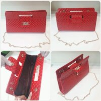 "Used Elegant red D&C sling bag "" brand new in Dubai, UAE"