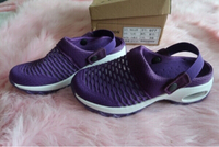 Used Purple covered shoes crocs like in Dubai, UAE