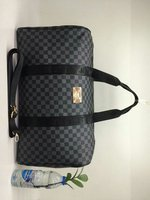 Traveling bag chequered
