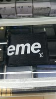 Used Supreme LV Bi-fold wallet for men in Dubai, UAE