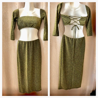Used 2 pcs gold shiny dress size M  in Dubai, UAE