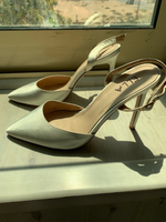 Used Satin white heels size 39 used once  in Dubai, UAE
