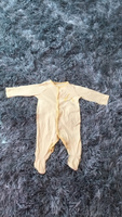 Used Yellow/white stripped onesie for babies. in Dubai, UAE