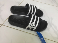 Used Adidas slippers size 40, new in Dubai, UAE