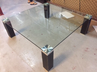 Used Glass table with leather  in Dubai, UAE