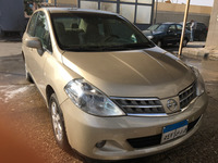 Used Nissan Tida 2009 Gold It's Very Good To Ride, Promotion In Price  in Dubai, UAE