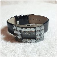Fashionable black watch for lady.