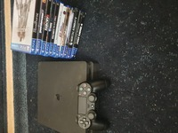 Used Ps4 slim 1Tb with 12 games in Dubai, UAE