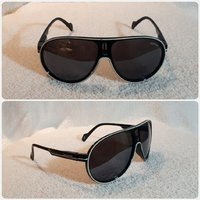Used Unisex black sungglass in Dubai, UAE