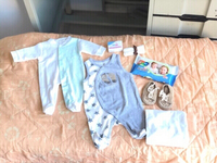 Used Baby romper,wipe,wrap,bar & free booties in Dubai, UAE