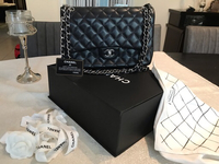 Used Chanel Black leader jumbo handbag in Dubai, UAE