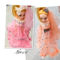 Used 2 Cute Doll pink & orange 💙 in Dubai, UAE