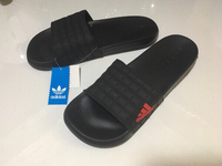 Used Adidas slippers size 43, new in Dubai, UAE