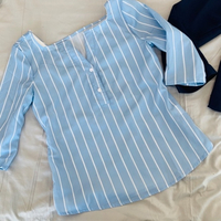 Used blue top fits small-medium  in Dubai, UAE