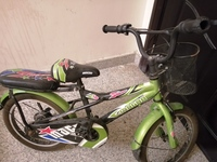 Used Kids Bicycle with partner seat in Dubai, UAE