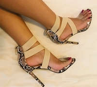 Used HIGH HEELS / PEEPS SNAKE PRINT/ Size38  in Dubai, UAE