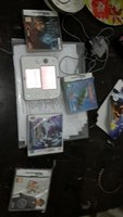 Used Nintendo 2ds with 4 games and a adapter in Dubai, UAE