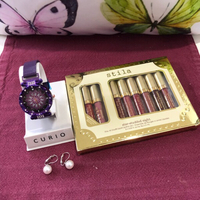 Used Lipsticks 2 Watch/Drop Earrings  in Dubai, UAE