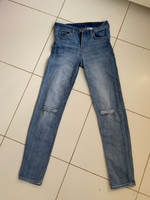 Used H&M high waist ripped jeans  in Dubai, UAE