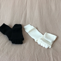 Used Toe separation socks black and white in Dubai, UAE