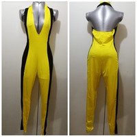 Cute yellow and black jum0p suit size M