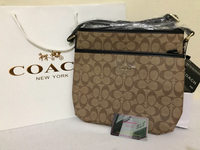 Used Coach 2 pockets dark brown lining in Dubai, UAE