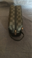 Used Lv hand pouch new  in Dubai, UAE