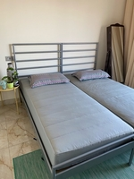 Used 2 single beds with mattresses in Dubai, UAE