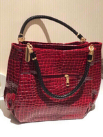 Used Red crocodile leather handbags  in Dubai, UAE