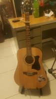 Used Acoustic Guitar,free stand, Capo and bag in Dubai, UAE