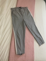 Used Zara grey and whitepants  in Dubai, UAE