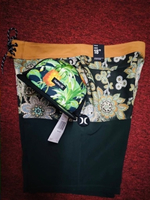 Used HURLEY SHORTS AND CUP BUNDLE OFFER!! in Dubai, UAE