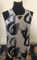 Used DA black n white Vest - Size Large in Dubai, UAE