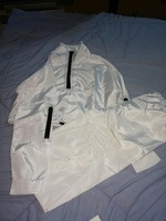 Used New water proof white training suit in Dubai, UAE